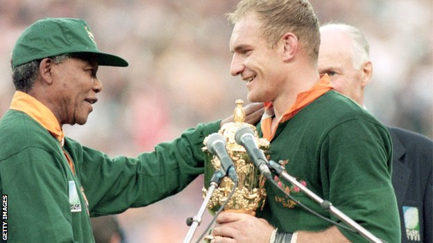 Mandela handing over the World Cup trophy